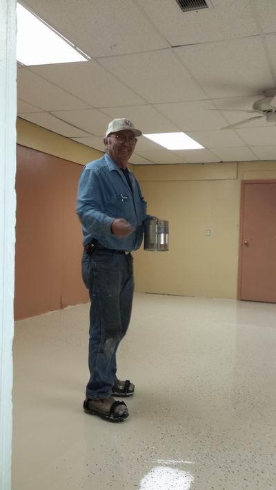 Howard sprinklin the floor