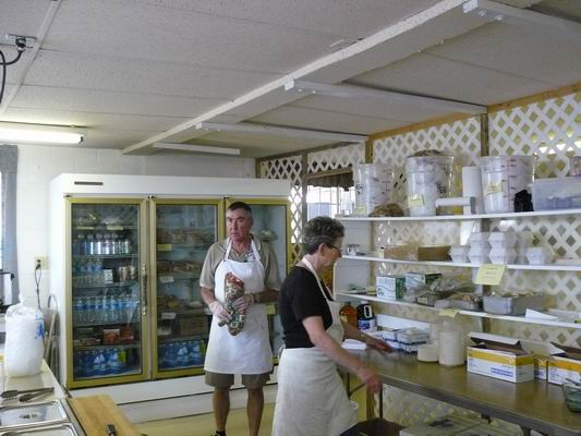 Volunteers working inside the concession prep area.