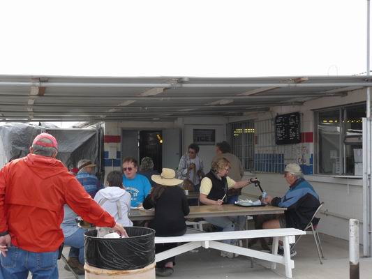 Hungry Vendors and Buyers enjoying their great meals from the Concession Stand