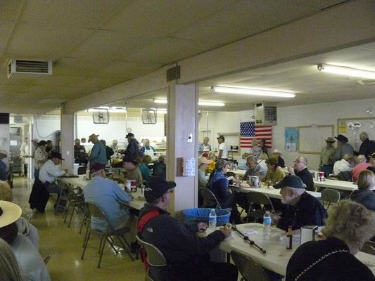 Buyers enjoying a great meal cooked inside the QIA cafeteria - all by volunteers!