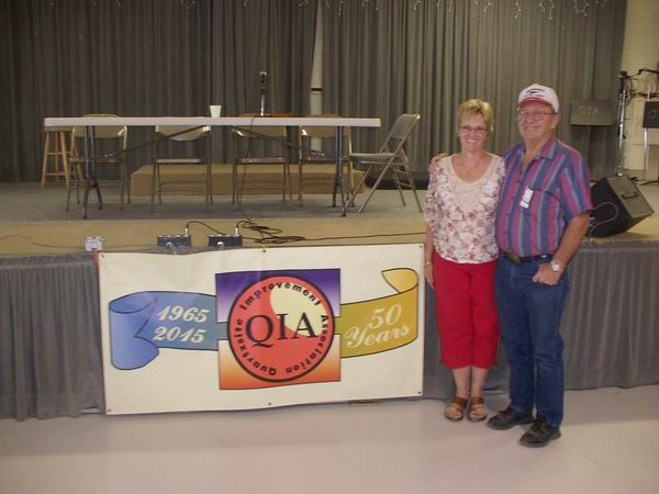 Howard & Sandy at the 50th Anniversary Banner of the QIA