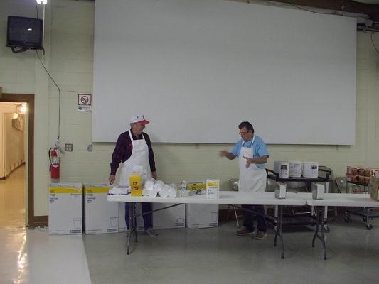 Howard & John getting ready to serve the volunteers