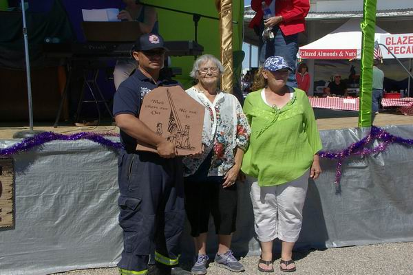 Jose from Quartzsite Fire & Rescue accepting plaque from Rainbow Acres