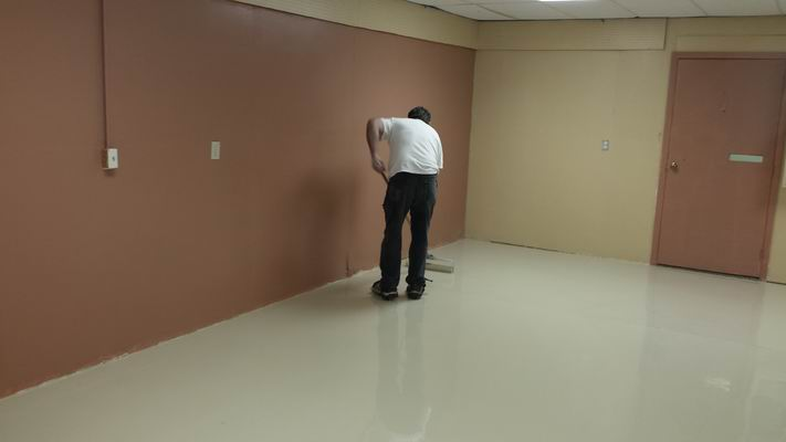 John rolling the paint onto the Hobby Room Floor